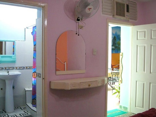 'Bedroom entrance and en suite bathroom' Casas particulares are an alternative to hotels in Cuba.