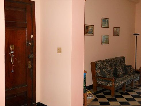 'Living room and entrance to the apartment'