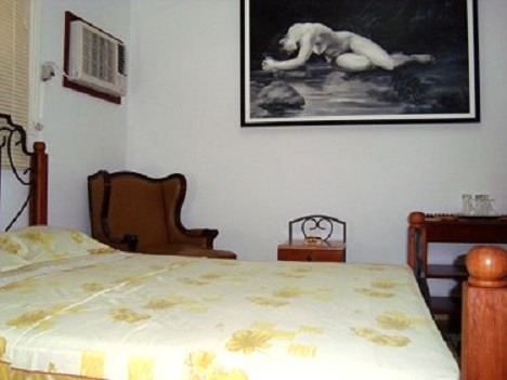 'Bedroom in the house of the owners (below the independent apartment)' Casas particulares are an alternative to hotels in Cuba.